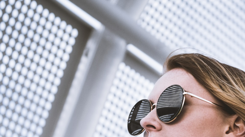woman wearing round black sunglasses