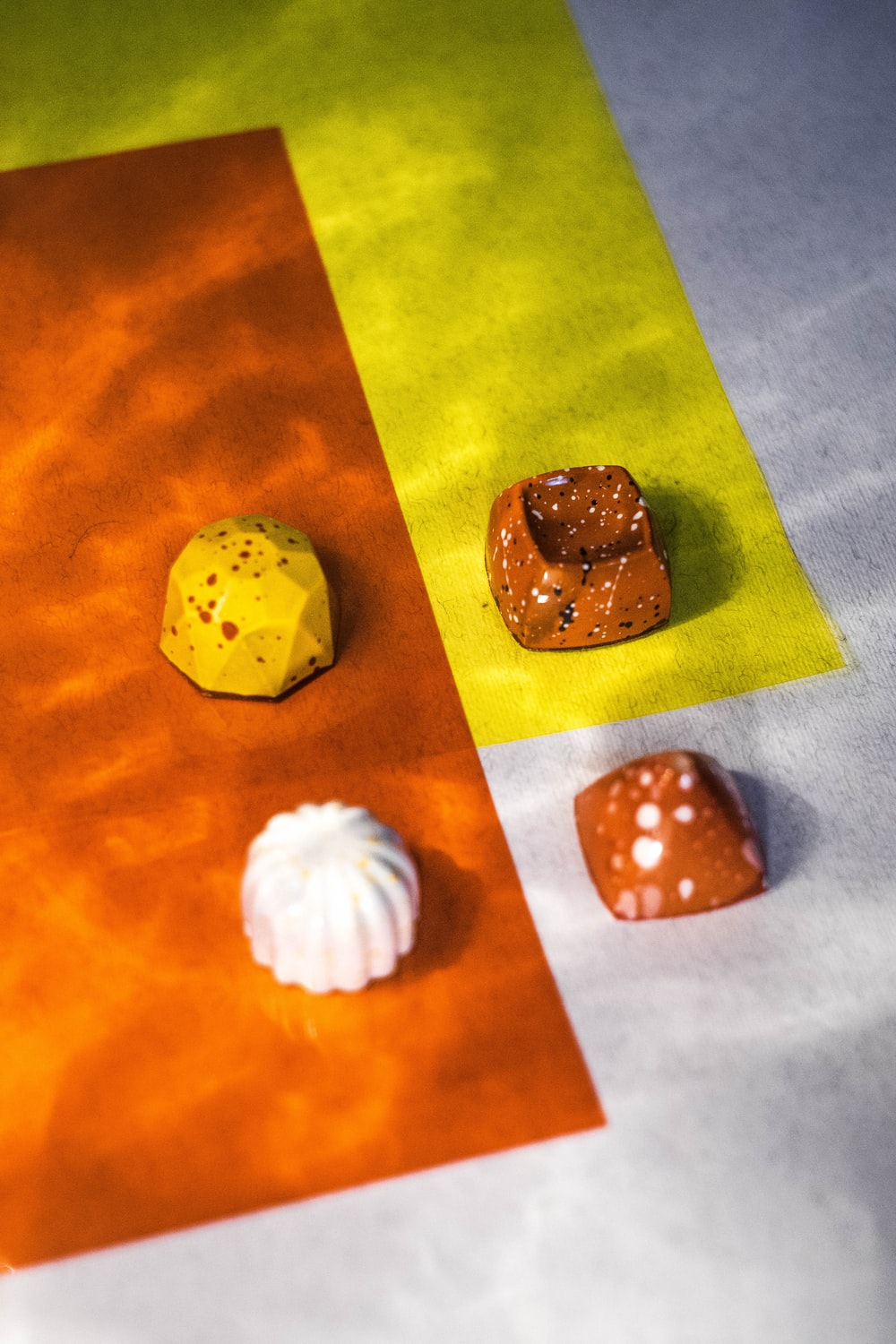 four assorted candies on top of white surface