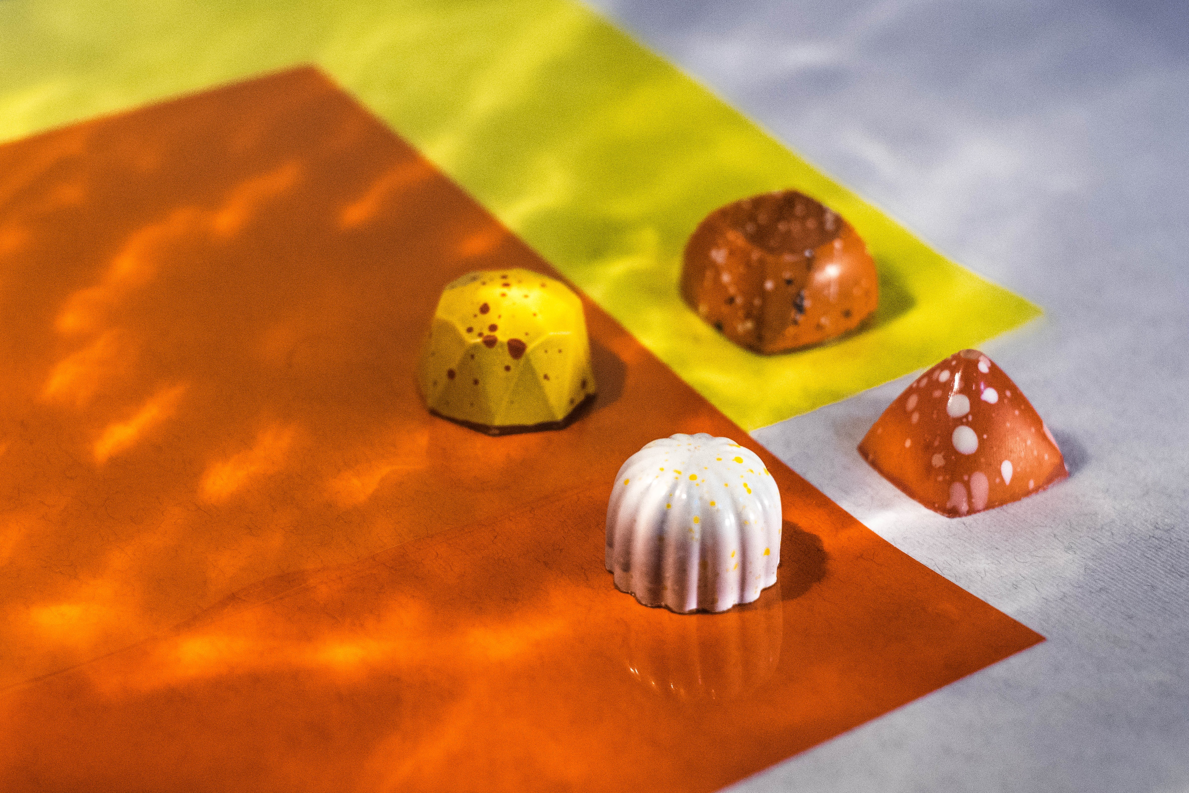 four assorted-shape chocolates
