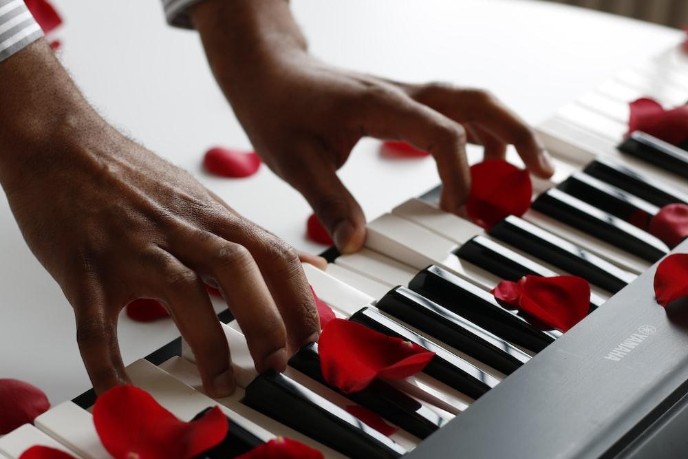 person playing electronic keyboard