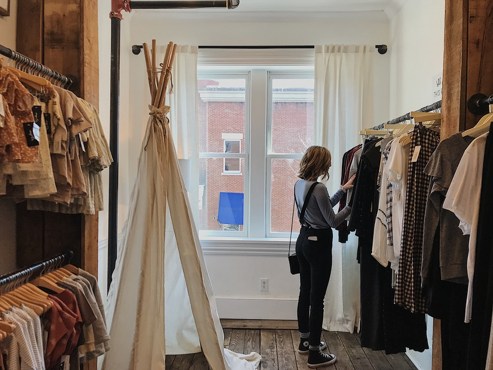 woman standing selecting clothes