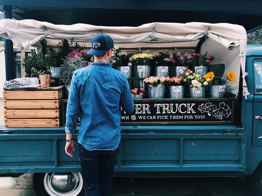 man facing flower truck