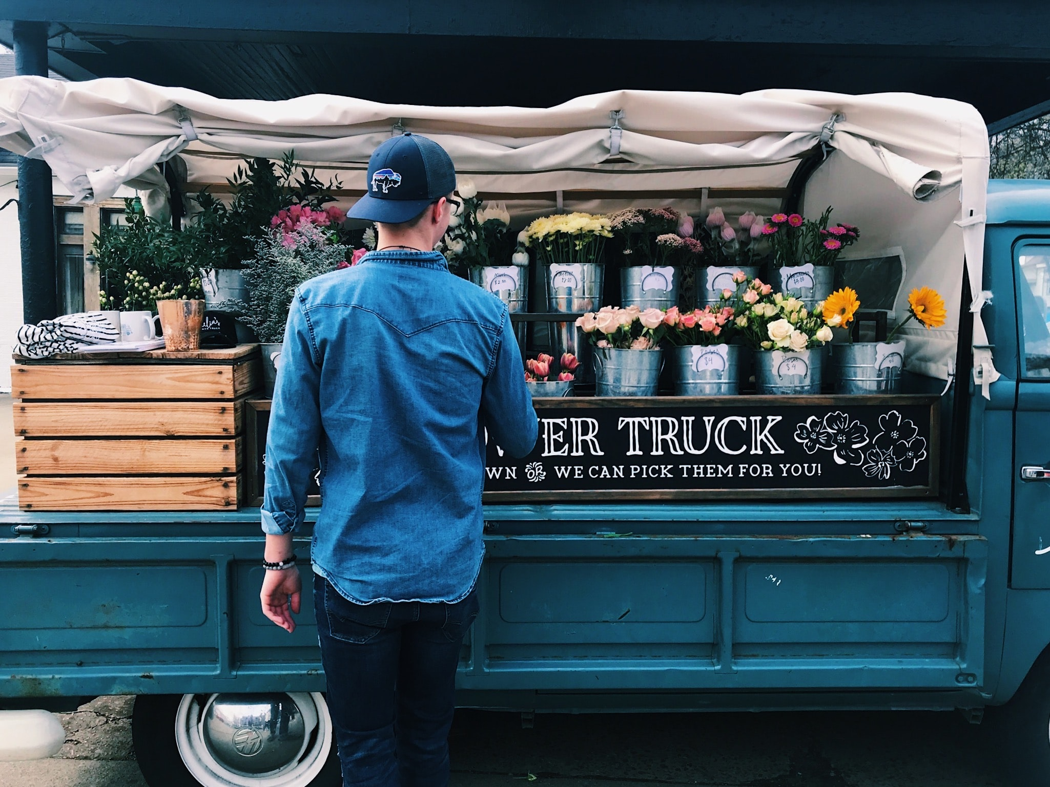 man facing flower truck