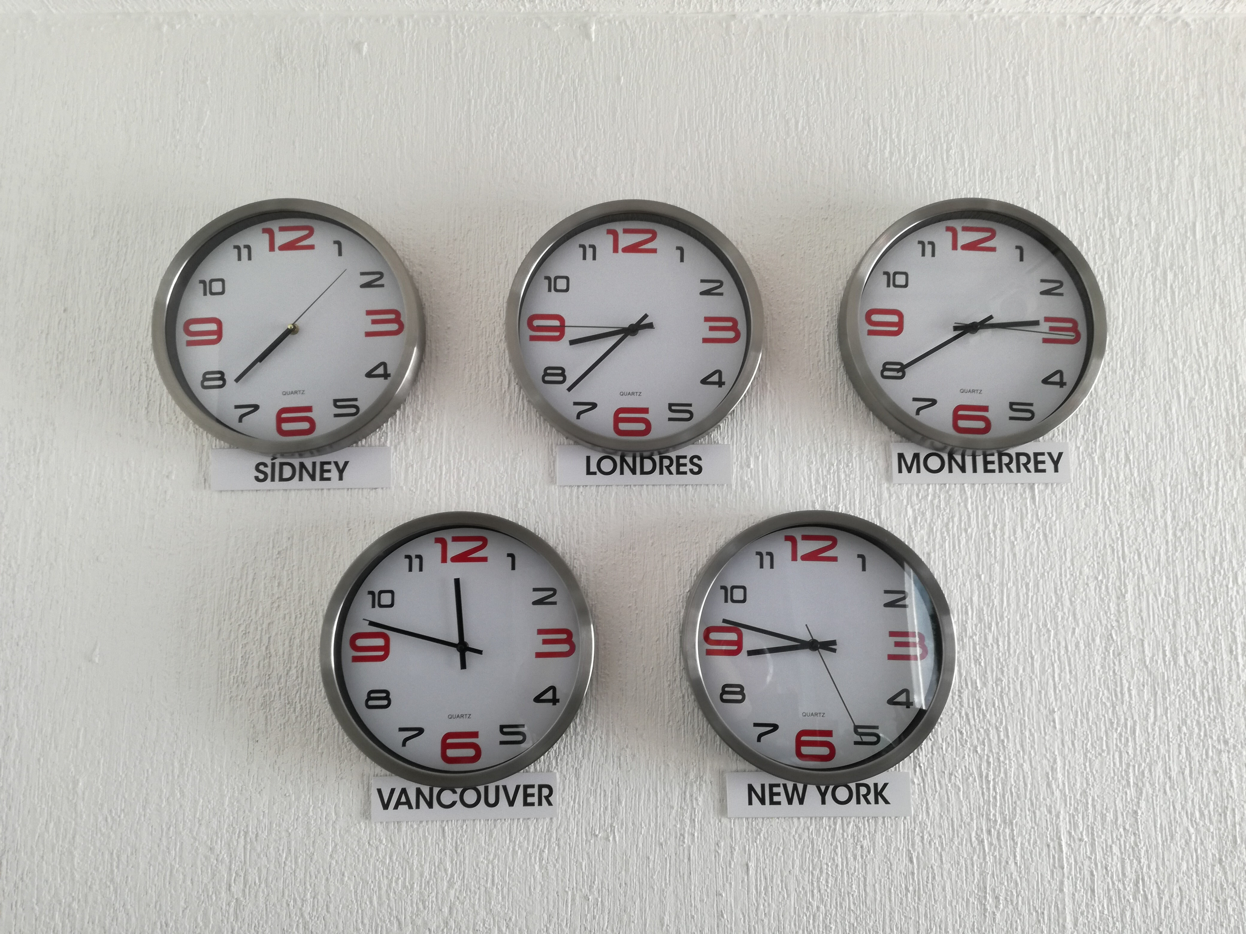 five assorted country wall clocks