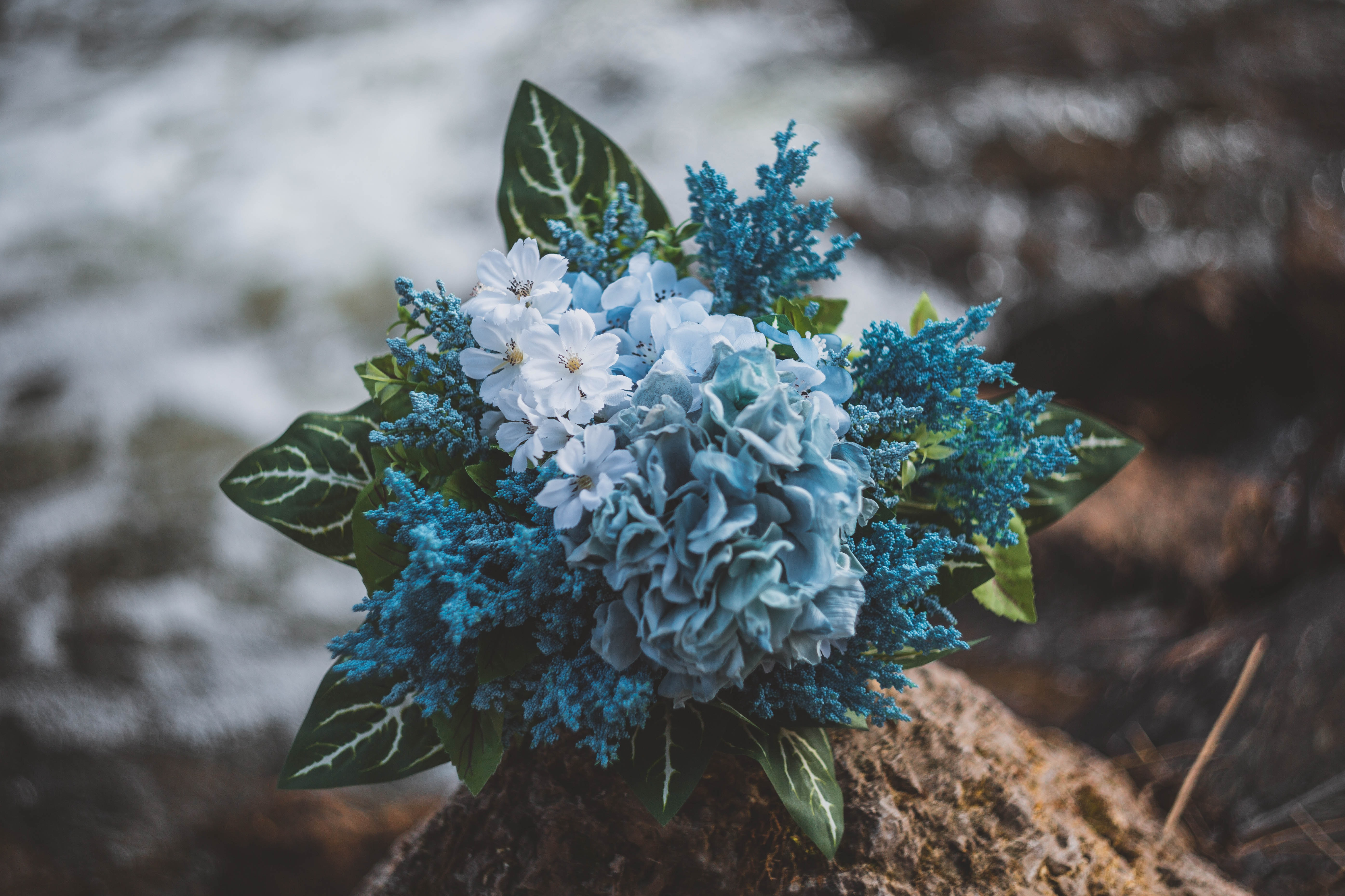 green and blue petaled flower bouquet
