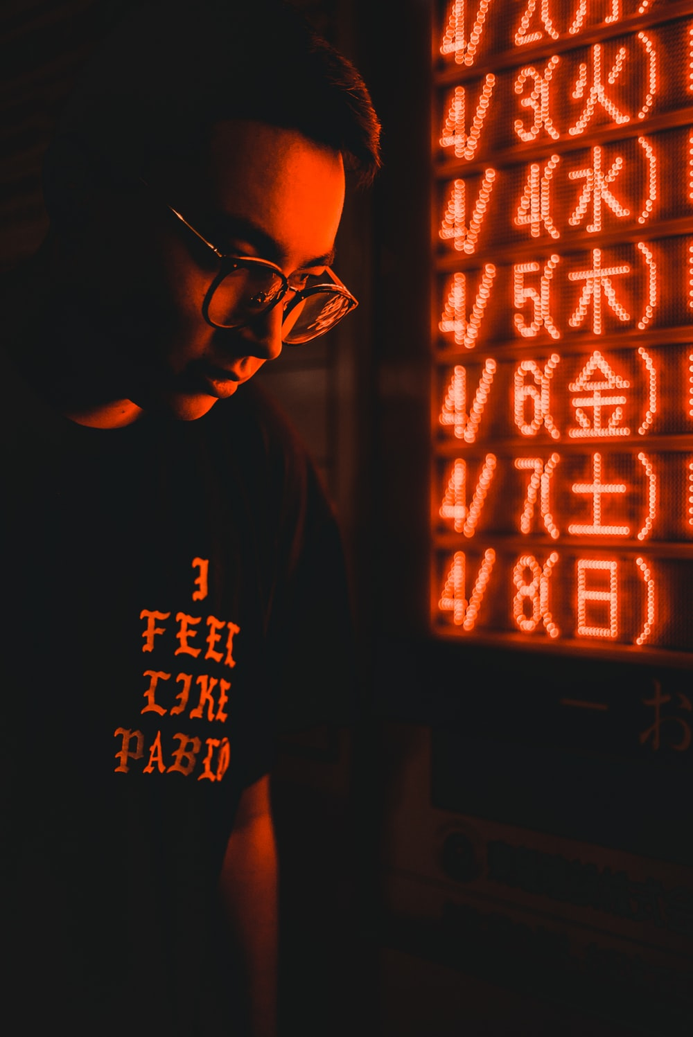 man standing near LED signage