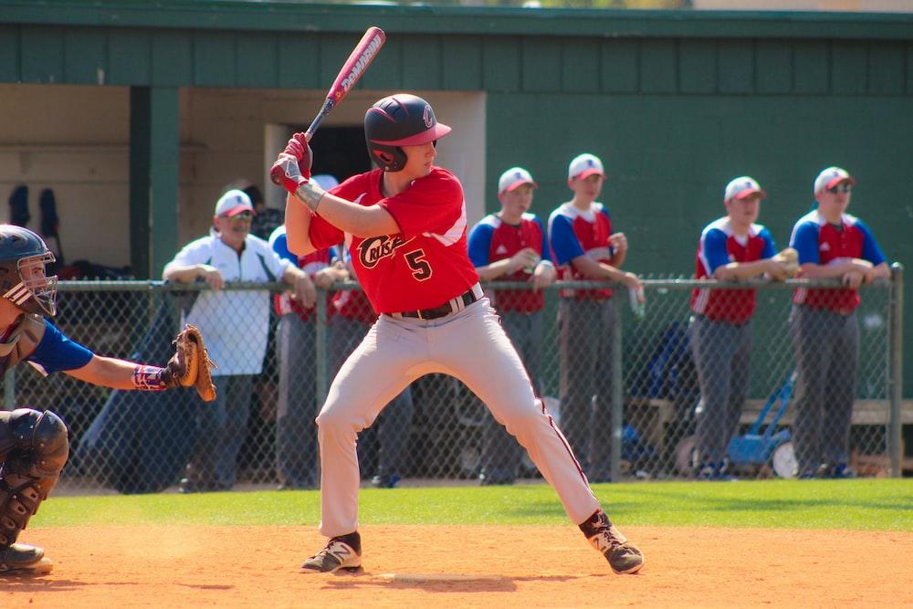 baseball playing posing to hit ball