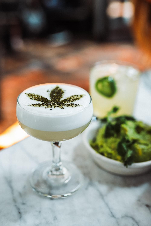 wine glass with cannabis leaf decor