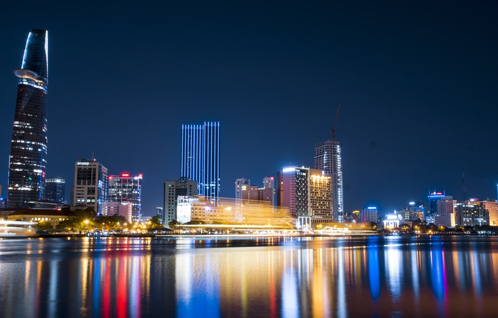 city buildings beside body of water