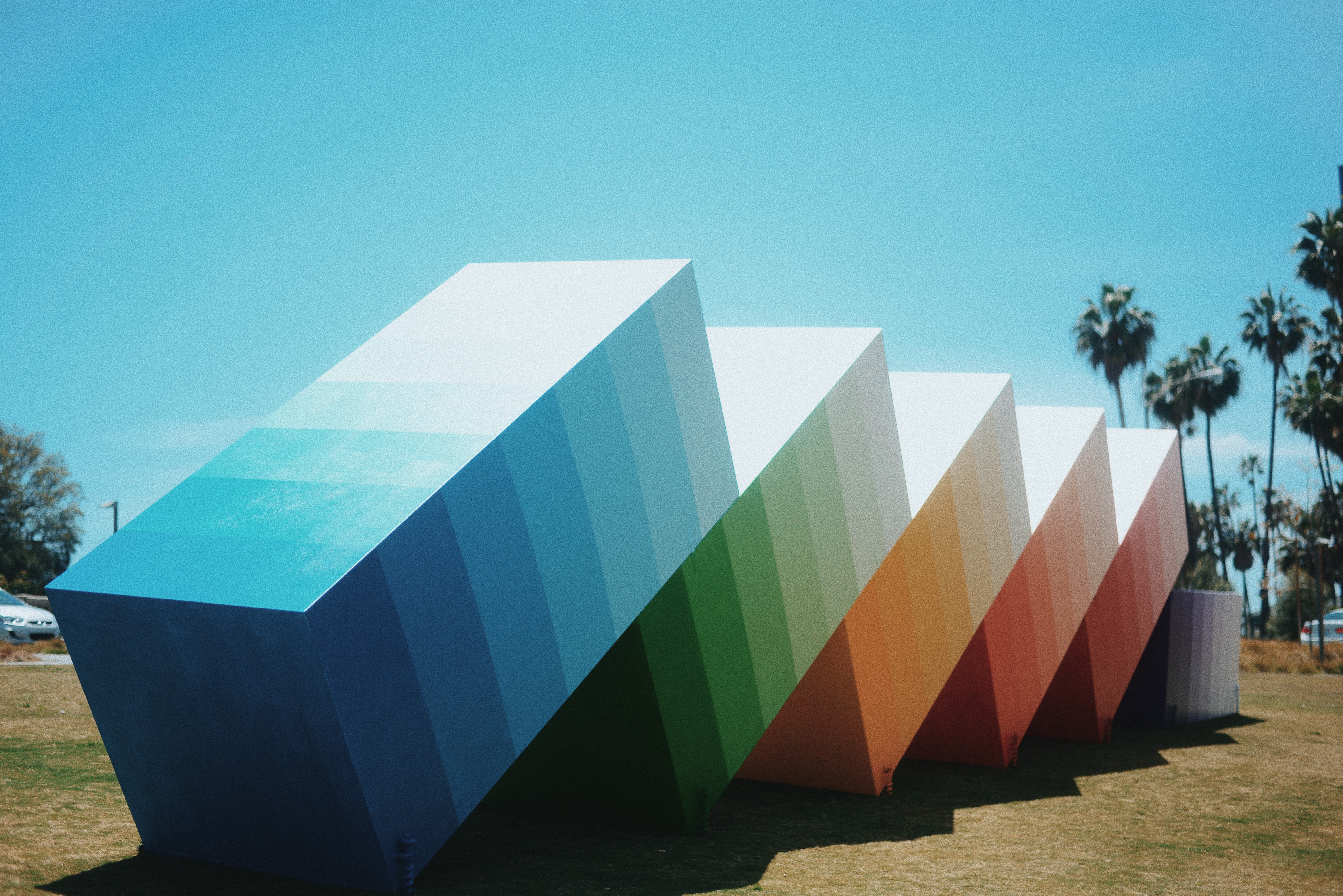 multicolored stair cube on grass field