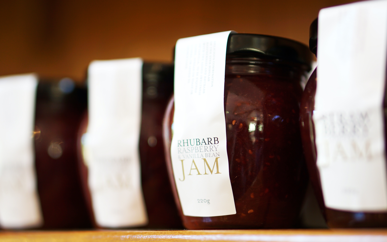 selective focus photography of Rhubarb Jam jars
