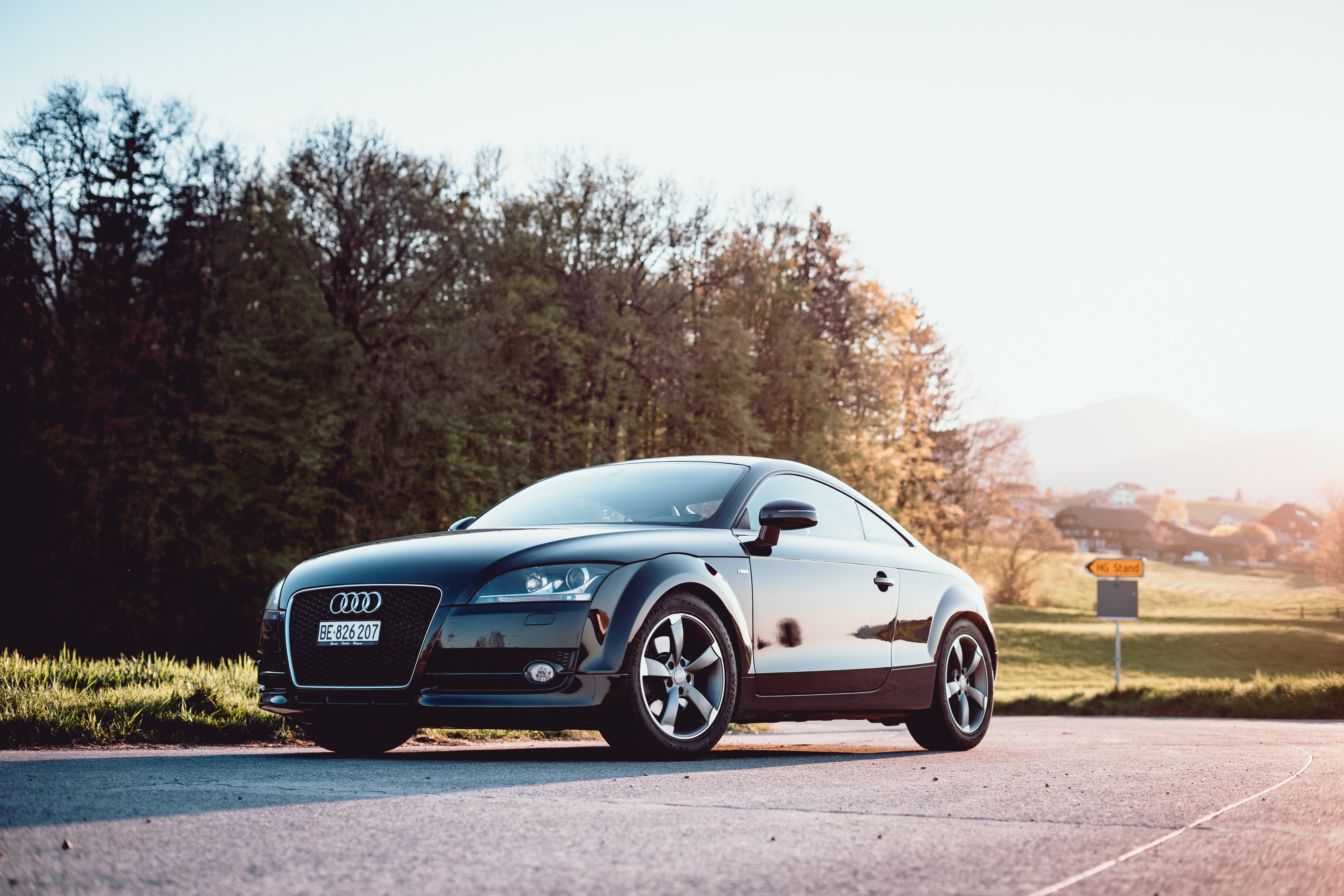 black Audi coupe parked on gray concrete road
