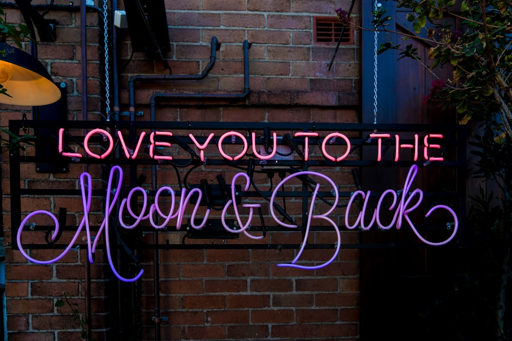 red and purple neon light signage