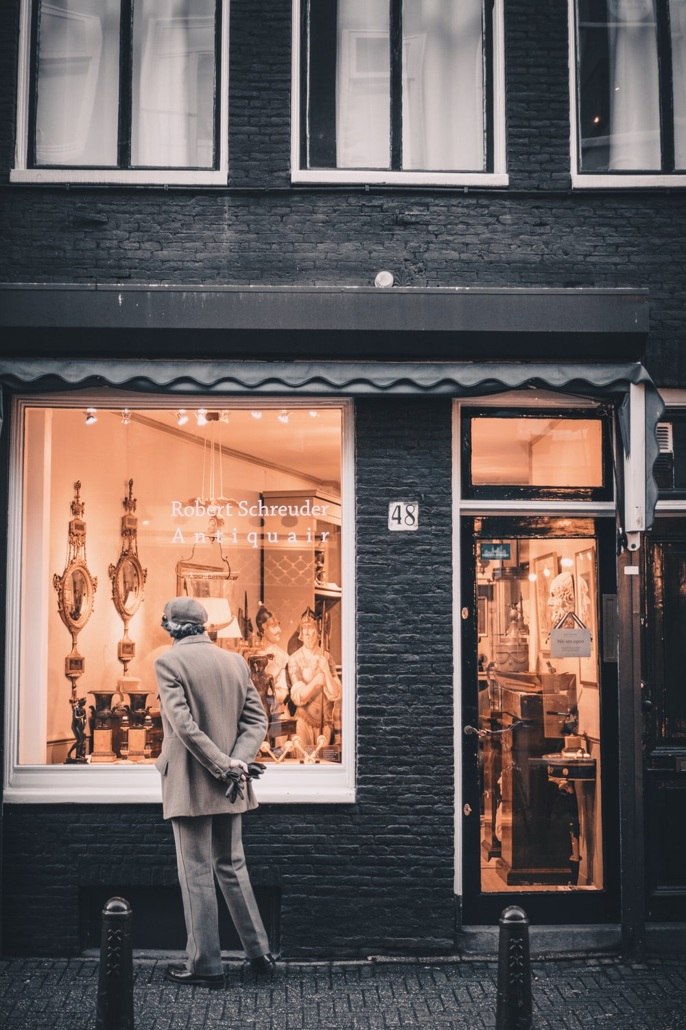 man standing in front of storefront
