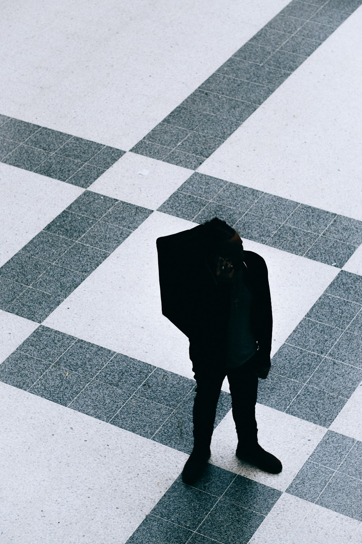 silhouette person walking on ceramic flooring