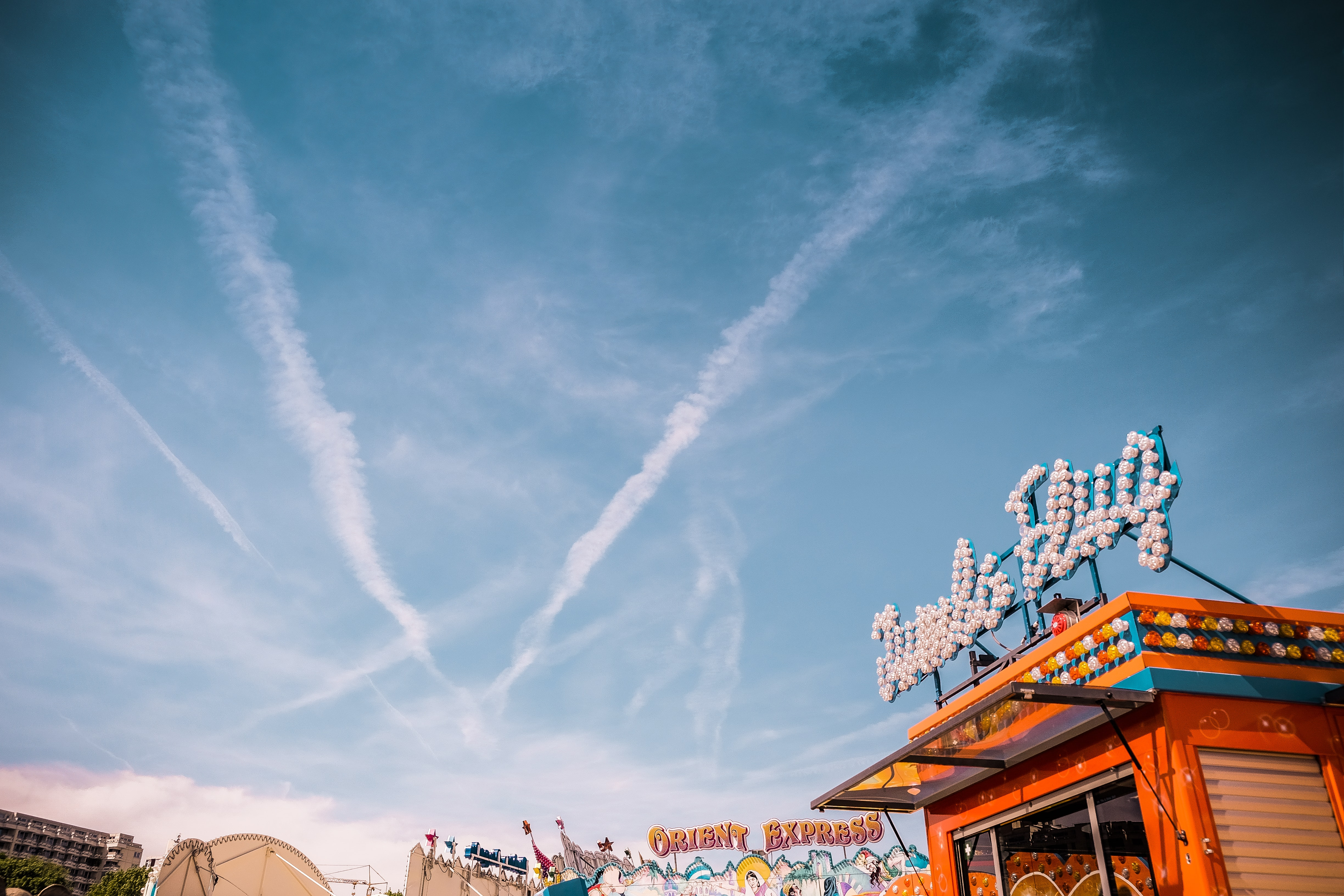low-angle photography of carnival under blue sky