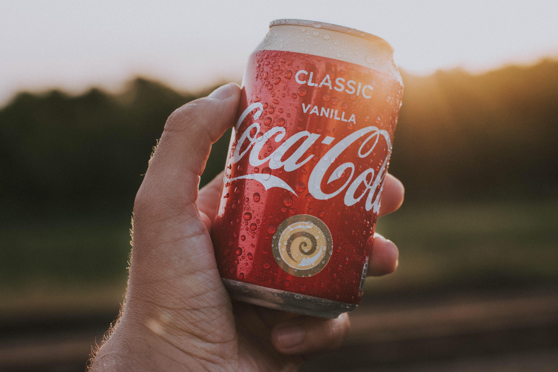 person holding Coca-Cola can