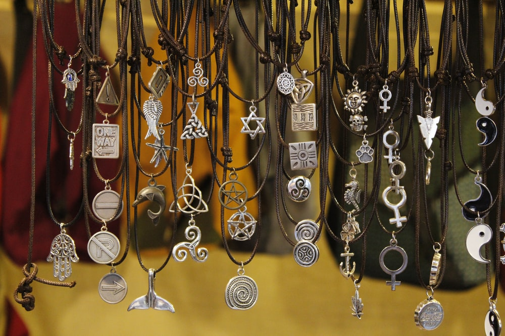 assorted-type silver-colored necklaces close up photography