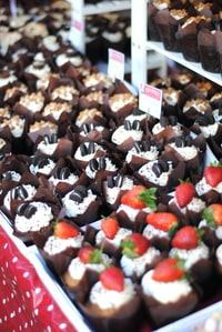 chocolate cupcakes with strawberries and cookies
