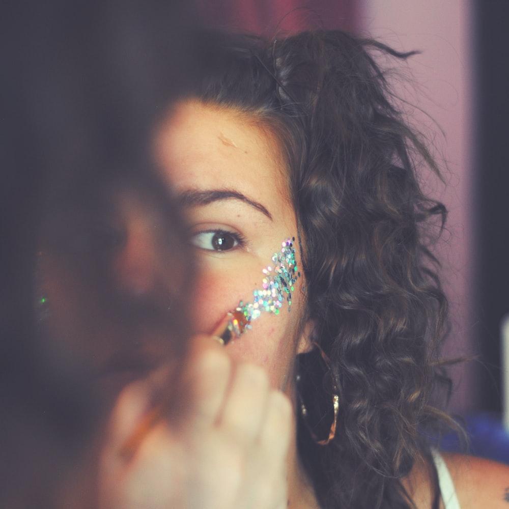 woman putting face paint