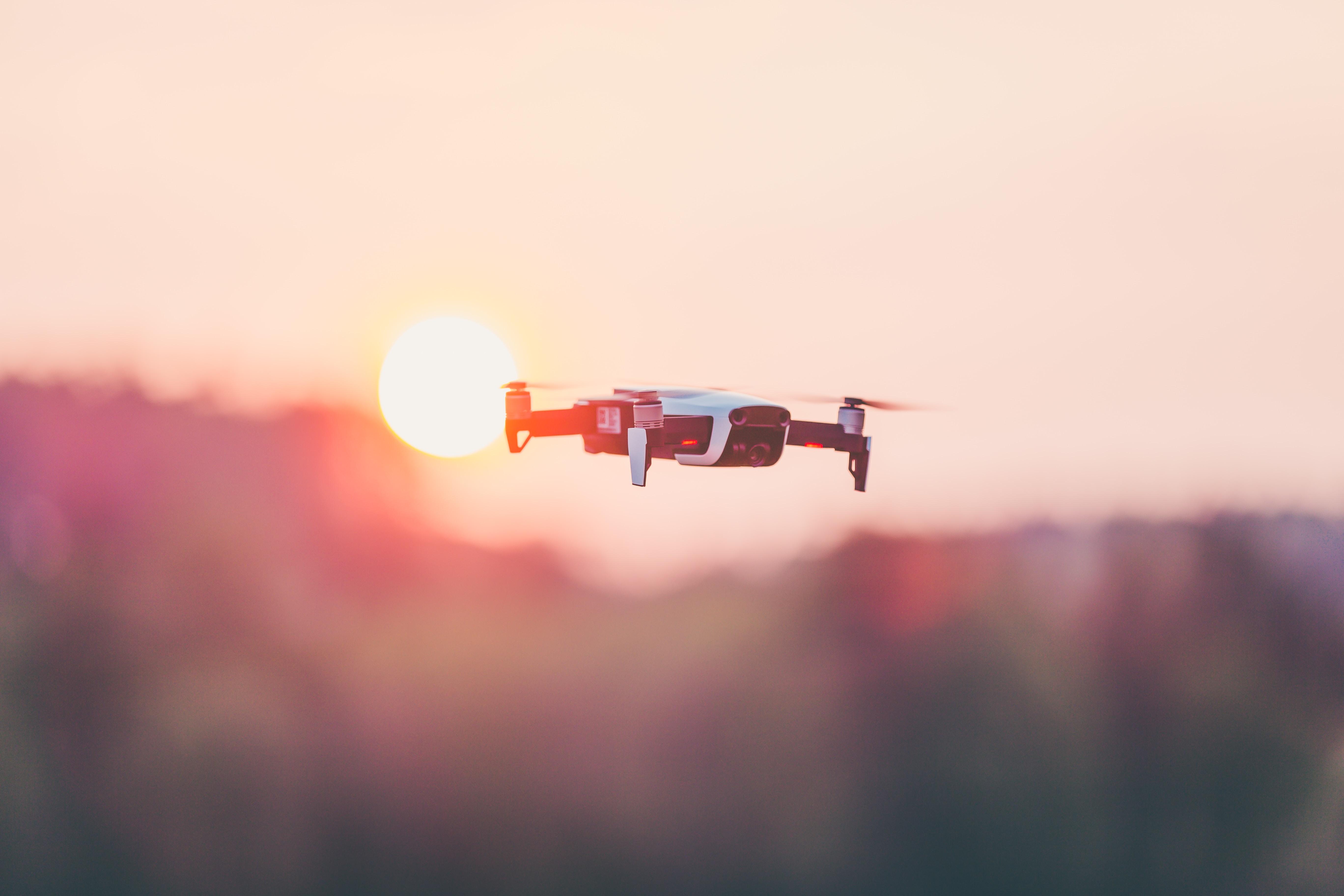black and white quadcopter drone