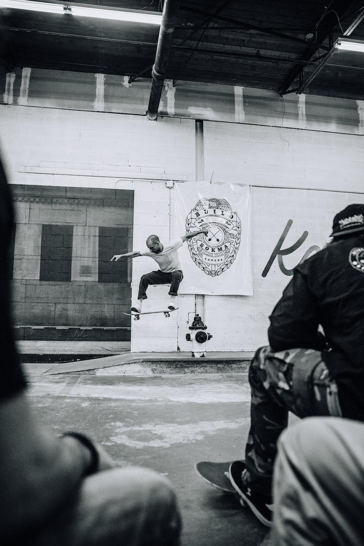 man riding skateboard near door