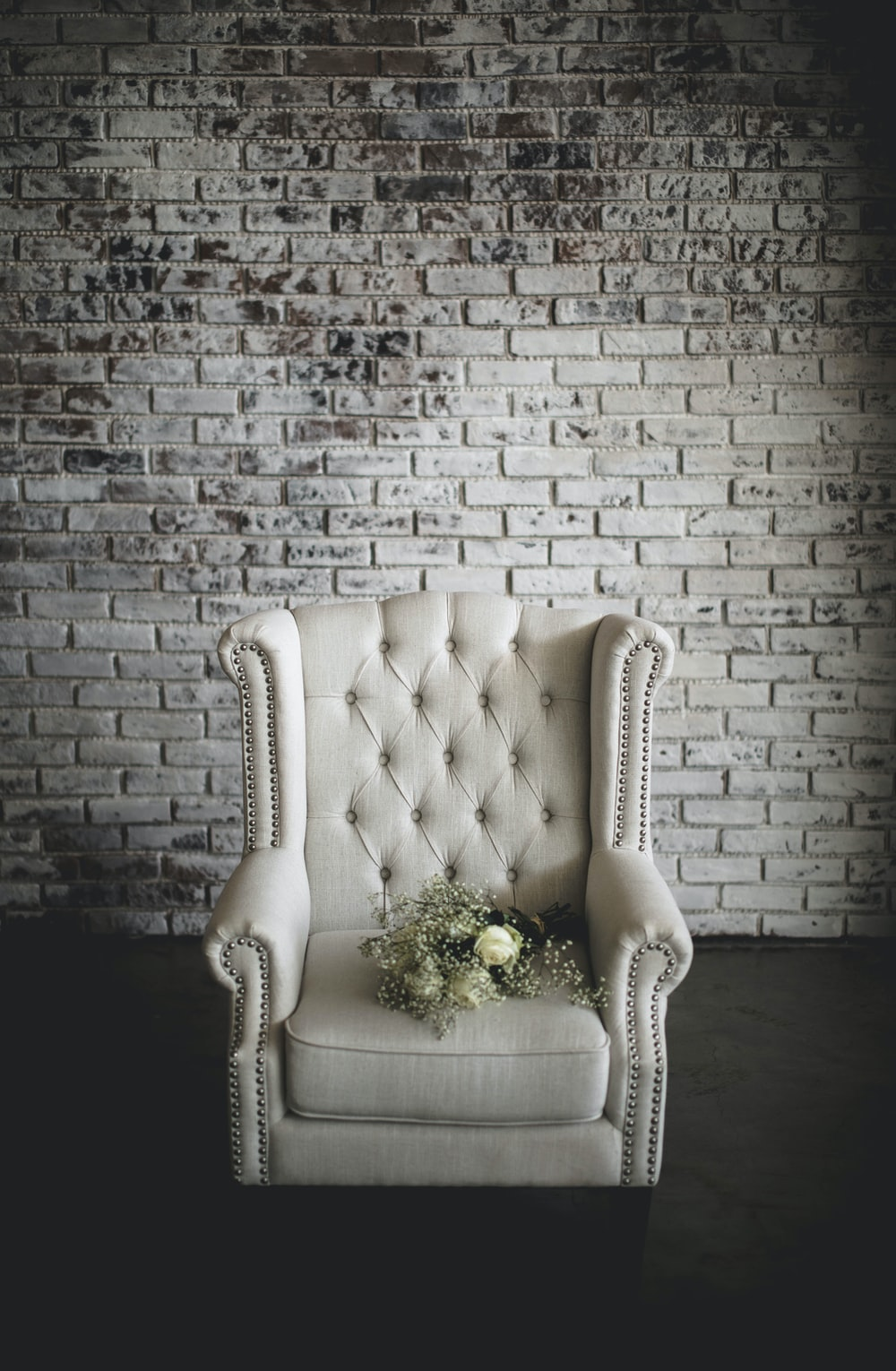 white flowers on top of white armchair