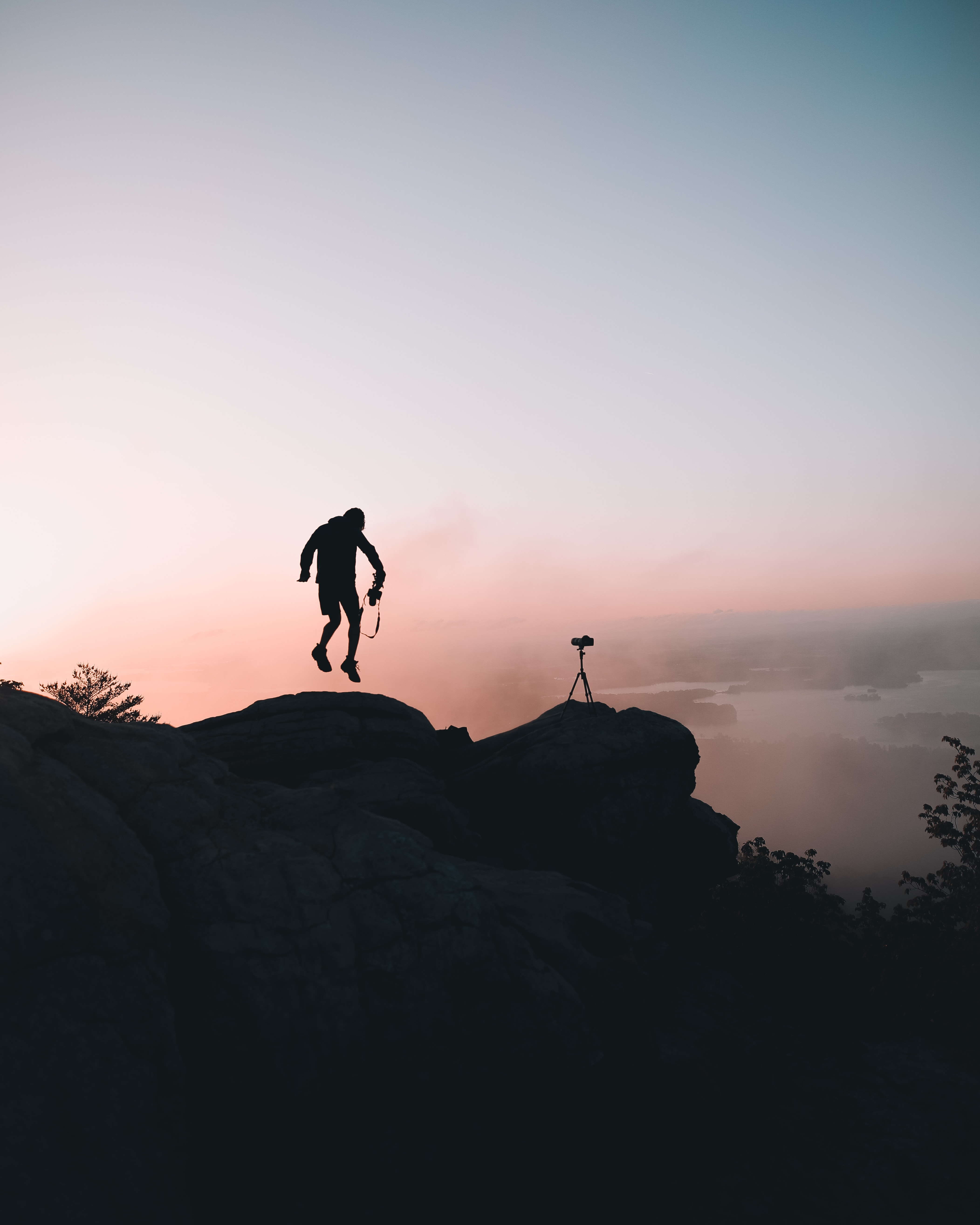 man jumping near cliff