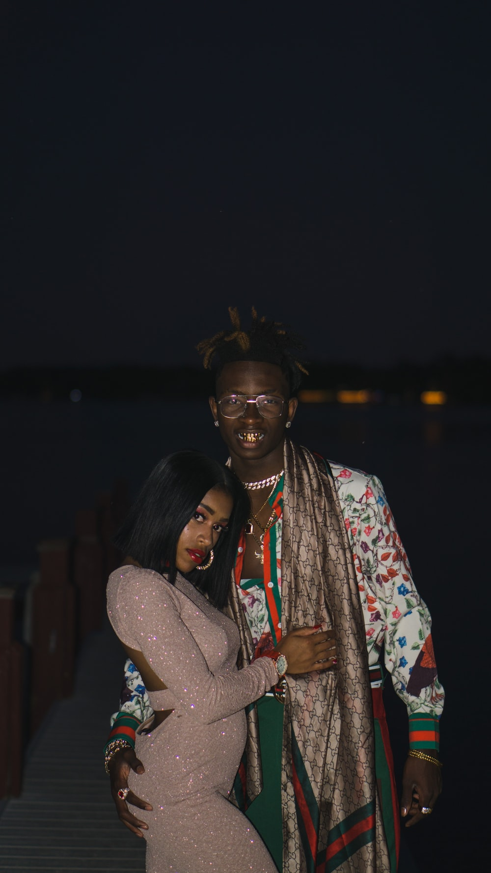 woman standing beside man during night time