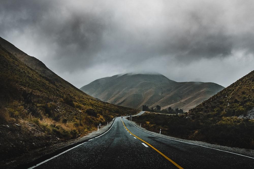 landscape photography of freeway near mountain range