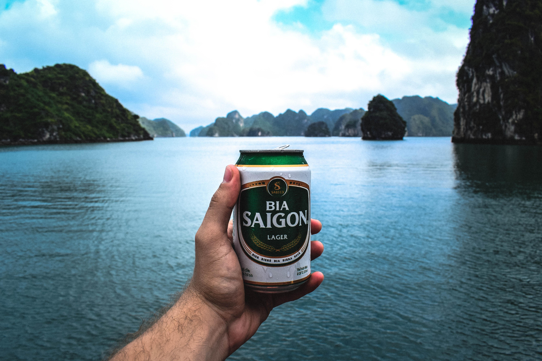 person holding Bia Saigon can