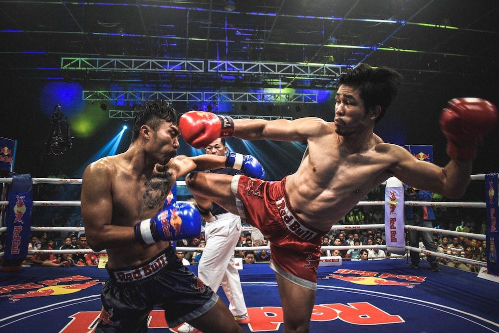 Muay Thai boxer kick opponent