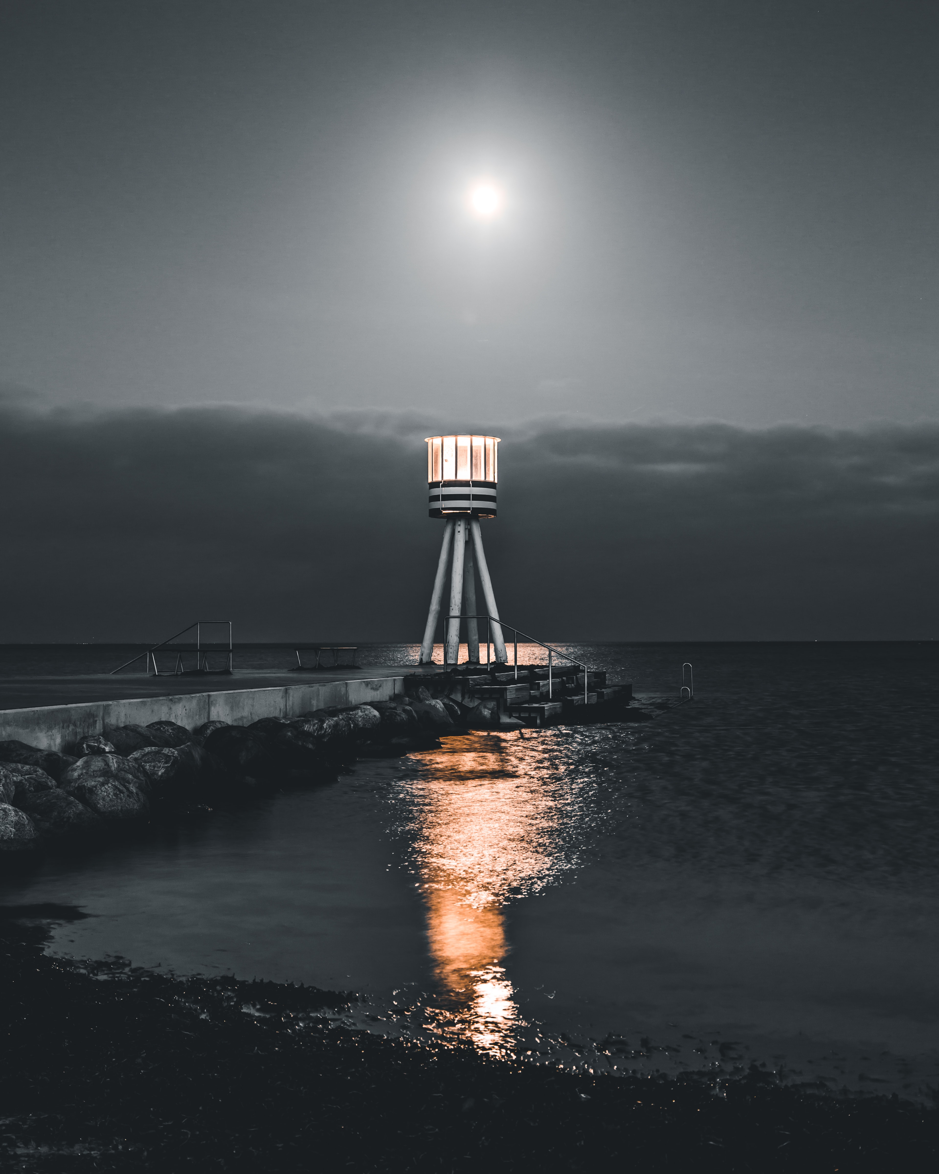 lighthouse at the dock during night
