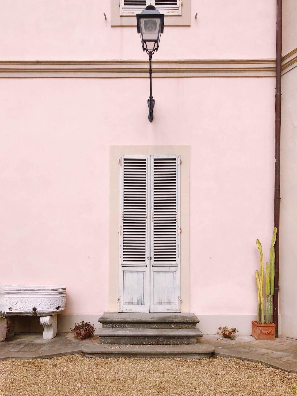 white wooden louver door
