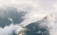 mountains with fogs during daytime