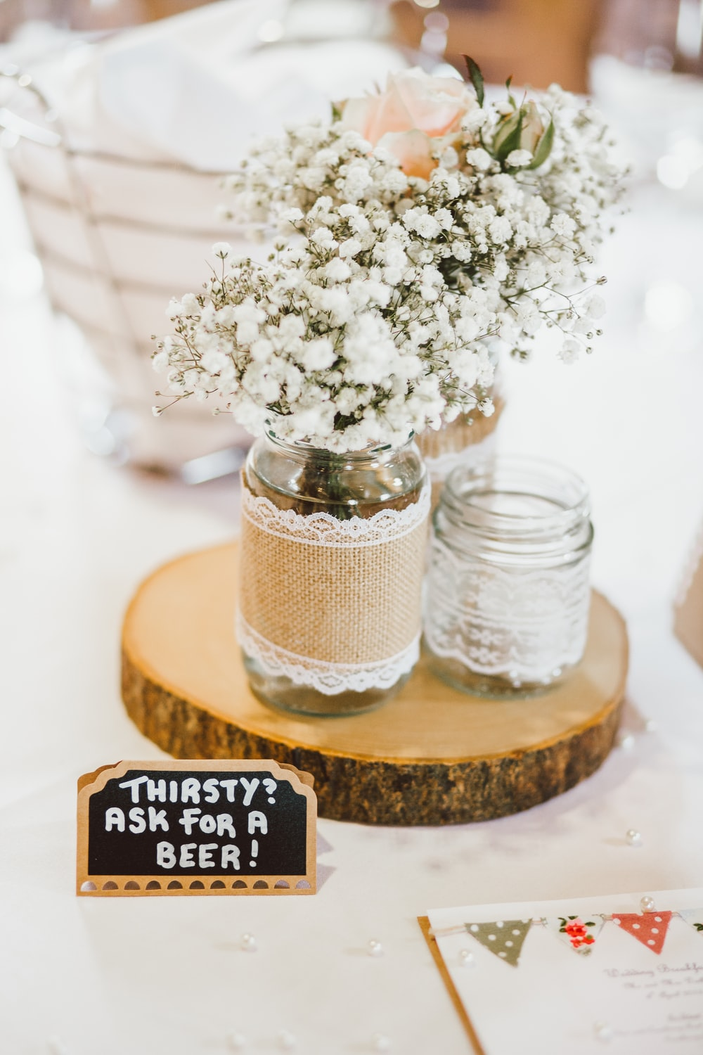 two clear glass vases with text overlay