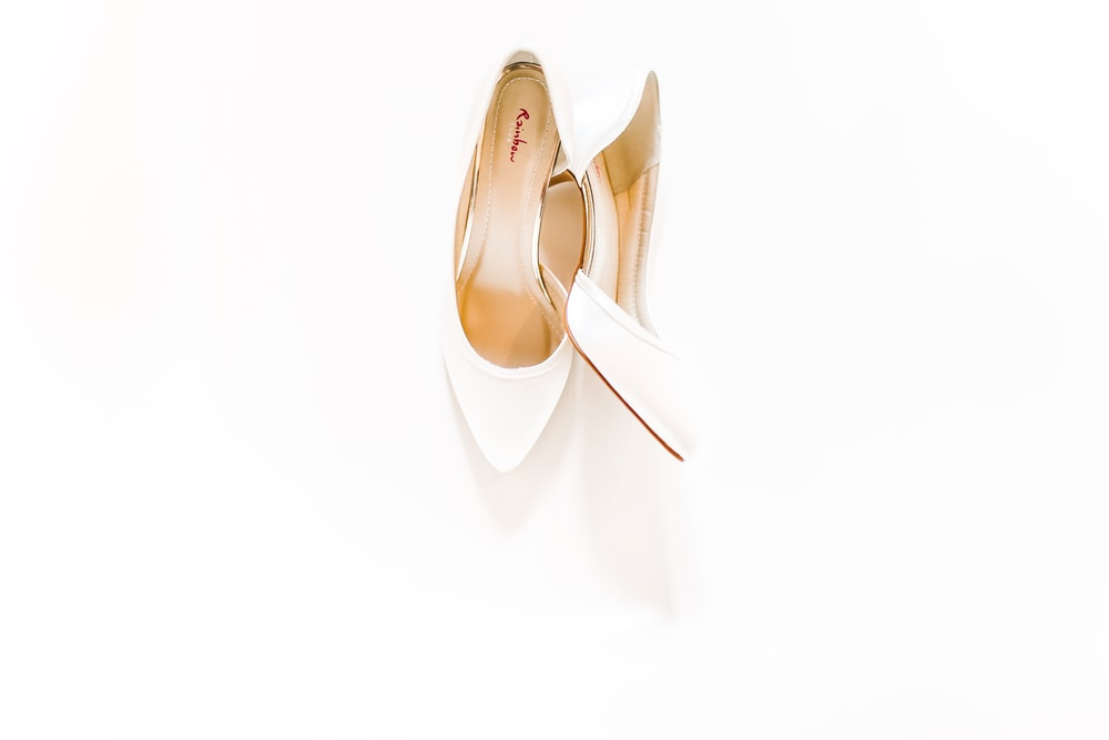 pair of white heeled shoes