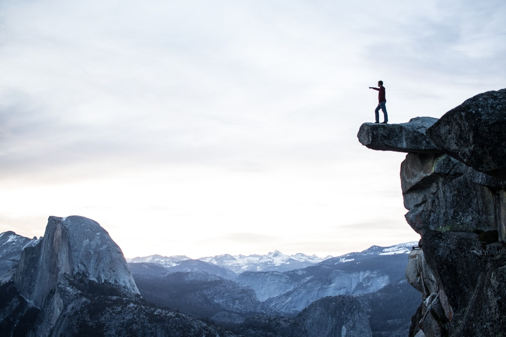 person standing on rocky cliff