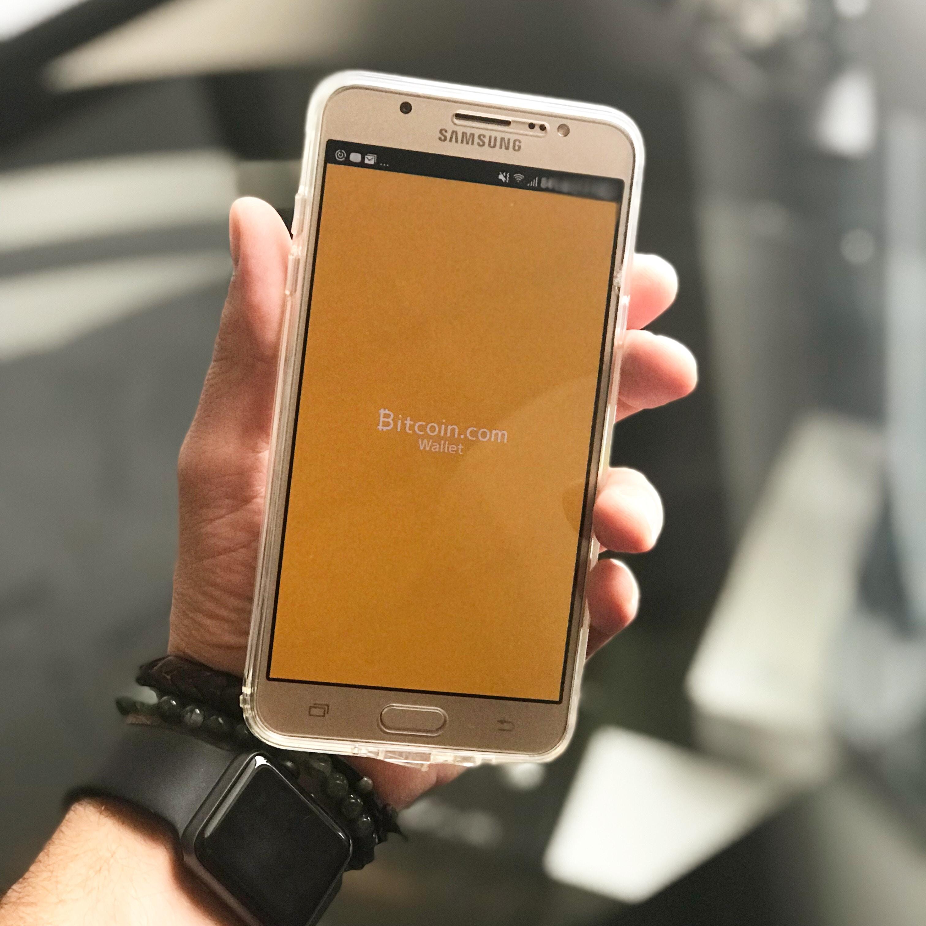 person using Samsung smartphone