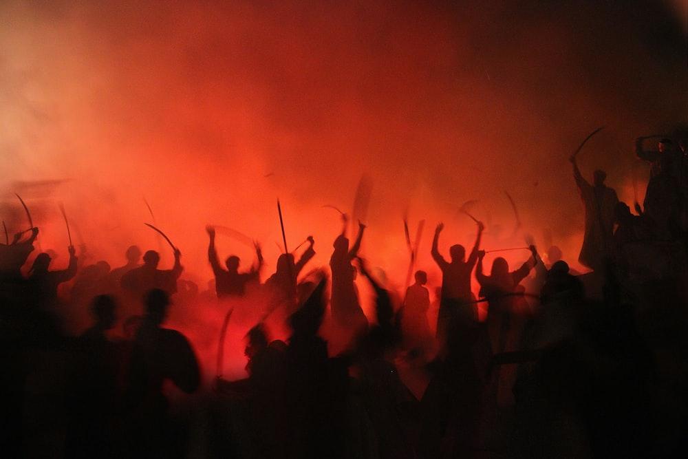 people gathering on street during nighttime