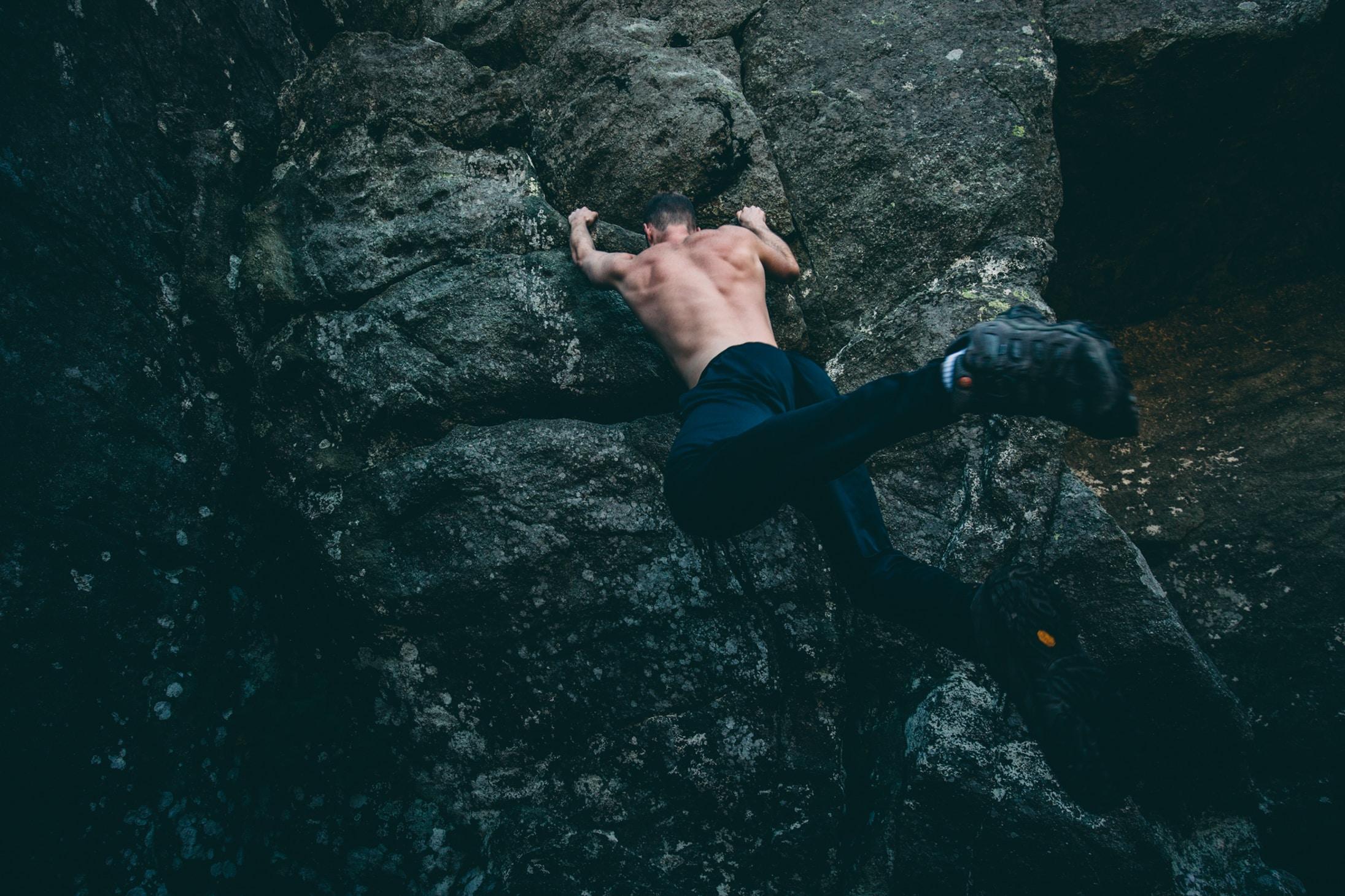 man rock climbing on gray rock