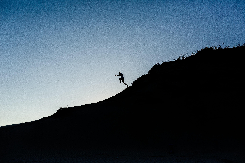 man jumping on mountain