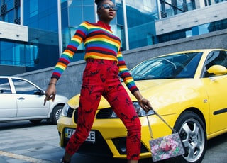 woman standing near yellow car