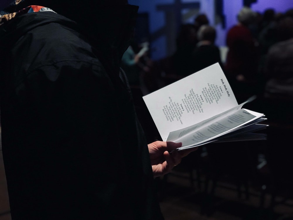 person standing while reading ook