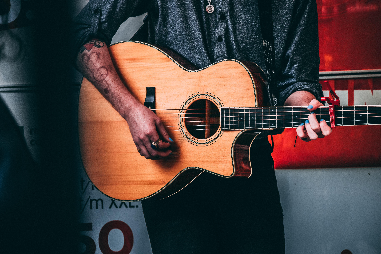 man using guitar