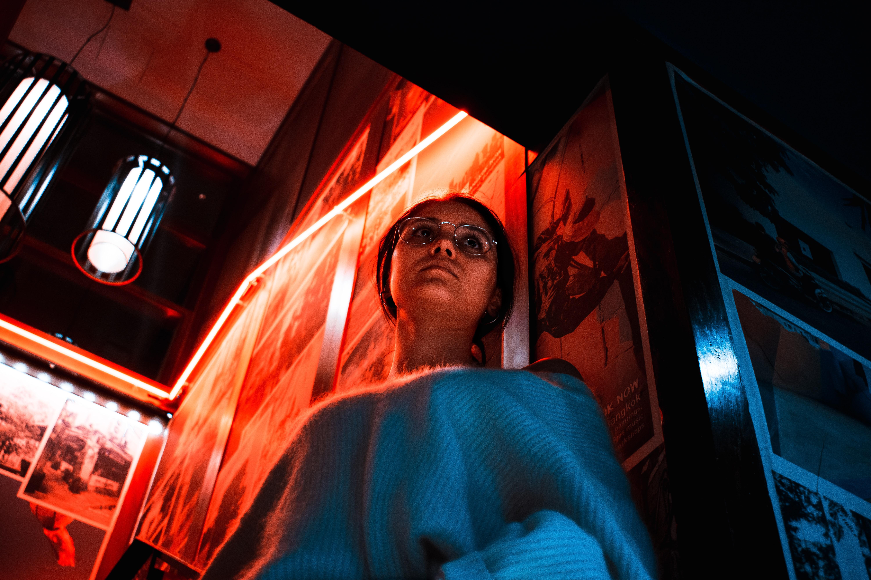 woman standing beside door frame