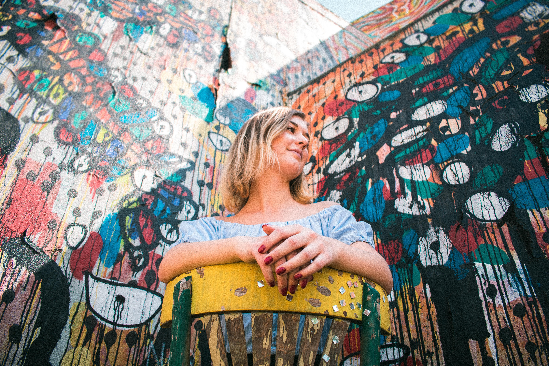 woman sitting in a corner wall gratify