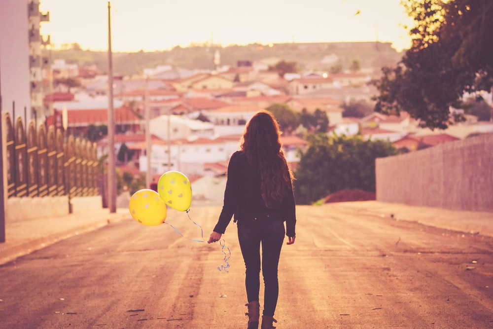 woman holding balloon