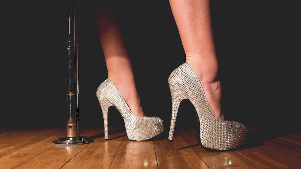 woman in gray platform stilettos