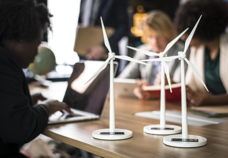 three white wind turbines miniatures on tables